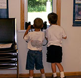 Boys Looking out window from building rental